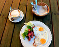 Sunny side up eggs with bacon and vegetables and coffee cup Royalty Free Stock Photo