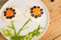 Sunny side up flowers eggs decorated with vegetables kid food Stock Image