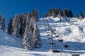 Sunny ski slope and ski lift near megeve in french alps france Stock Photos
