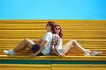 Sunny summer portrait stylish young cool couple teens rest Royalty Free Stock Photo