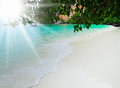 Sunny tropical beach on the island beautiful paradise in middle of sea Stock Photography