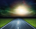 Sunny way road in the sunset in the clouds Royalty Free Stock Photography