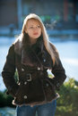 Sunny winter day beautiful blonde woman with long hair in a brown fur coat Stock Photo
