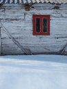 Sunny, winter day and detail of a mountain cottage in the snow Royalty Free Stock Photo