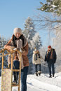 Sunny winter day people in snow countryside enjoy walking Royalty Free Stock Photo