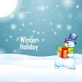 Sunny winter holiday and snowman with gift on snow background Royalty Free Stock Image