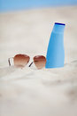 Sunprotection summer holiday sunglasses and cream Royalty Free Stock Photography