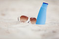 Sunprotection summer holiday sunglasses and cream Royalty Free Stock Photo