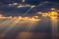 Sunrays between the clouds magical at sunset Royalty Free Stock Images