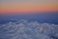 Sunrise on the alpine range snow peaks at swiss and italian alps aerial view Stock Images