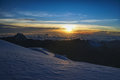 Sunrise in andes scenic from mountain peak above clouds bolivian Stock Photography