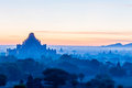 Sunrise in bagan view from high point dominating blue color silhoutes of temples trees vibrant sky with some clouds Stock Photo