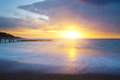 Sunrise beach reflections of rising sun on morning Royalty Free Stock Image
