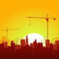 Sunrise Cranes And Construction Background Royalty Free Stock Images