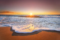 Sunrise with deep blue sky and sun rays. Royalty Free Stock Photo