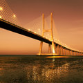Sunrise famous vasco da gama bridge lisbon portugal Royalty Free Stock Photo