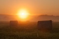 Sunrise at farm field foggy Royalty Free Stock Image