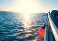 Sunrise on a fishing boat with a net in the sea Stock Image