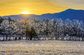 Sunrise and frost cades cove smoky mountains the warm sun rises over the cool valley floor a thick morning blankets the meadow in Royalty Free Stock Photography
