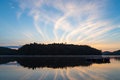 Sunrise lake of bays streaks in the sky relect on the as the sun rises over the narrows in muskoka ontario canada Royalty Free Stock Images