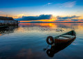 Sunrise on Lake Seliger with an old boat in the foreground. Royalty Free Stock Photo
