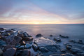 Sunrise lake superior rocky shore of during dusk time Royalty Free Stock Photos
