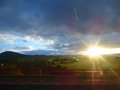 Sunrise landscape with hill and blue clouds Royalty Free Stock Photos