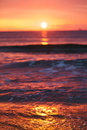 Sunrise light shining on ocean wave with orange tones Stock Photography