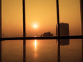Sunrise morning silhouettes of glass window with orange sunrise background view from high office building Royalty Free Stock Photography