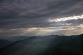 Sunrise in mountains sun rays breaking through dark clouds over darjeeling himalayas india Royalty Free Stock Photography