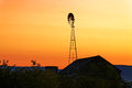 Sunrise on Old Barn and Windmill Royalty Free Stock Photo