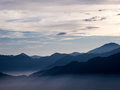 Sunrise over alishan taiwan with sunrays piercing through the clouds below Stock Images
