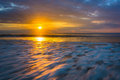 Sunrise over the Atlantic Ocean in Folly Beach, South Carolina. Royalty Free Stock Photo