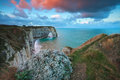 Sunrise over cliffs in atlantic ocean etretat france Stock Photography