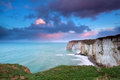 Sunrise over cliffs in atlantic ocean etretat france Stock Photo