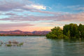 Sunrise over a Colorado Lake with Mountains in the Background Royalty Free Stock Photo