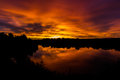 Sunrise over duddingston loch edinburgh scotland early morning Stock Photos