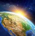 Sunrise over the Earth Royalty Free Stock Photo