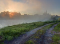 Sunrise over foggy lake Royalty Free Stock Photos
