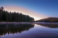 Sunrise over foggy lake Royalty Free Stock Photo