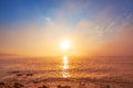 Sunrise over foggy sea Royalty Free Stock Photo