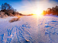 Sunrise over the frozen river winter landscape Stock Photo