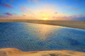 Sunrise over golden sands and azure waters the summer sun rises sand dunes blue Royalty Free Stock Images