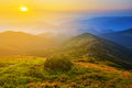 Sunrise over a mountain valley Royalty Free Stock Photo