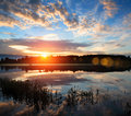 Sunrise over the river. Stock Images