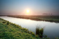 Sunrise over river on dutch farmland misty holland Royalty Free Stock Images