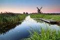 Sunrise over river and dutch windmill groningen netherlands Royalty Free Stock Photo