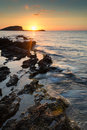 Sunrise over rocky coastline on meditarranean sea landscape in s beautiful seascape mediterranean Stock Photo