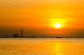 Sunrise over sea and industrial factory Royalty Free Stock Photo