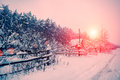 Sunrise over snowy village winte Royalty Free Stock Images
